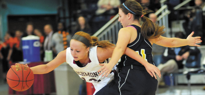 Richmond's Noell Acord, left, collides with Hyde's Shannon Ward in a Western Class D semifinal at the Augusta Civic Center. Richmond advanced to the regional final with a 43-36 victory.