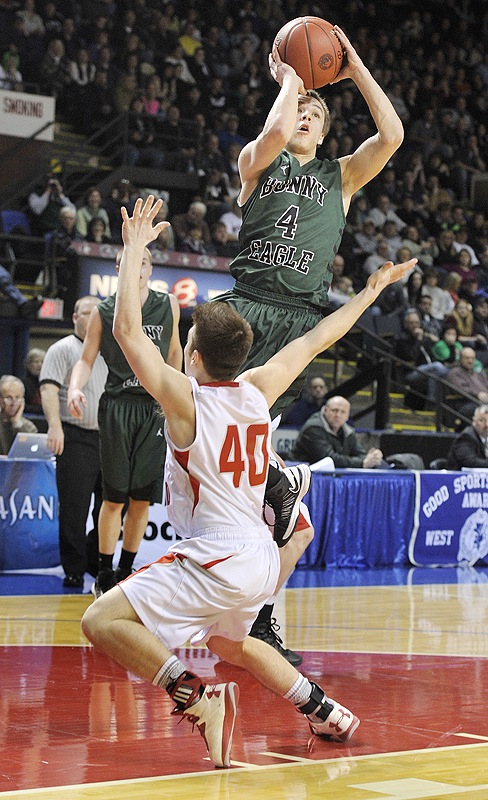 Dustin Cole, who scored 36 points Saturday night for Bonny Eagle, pulls up for a shot against Trevor Borelli of South Portland in the Western Class A final.