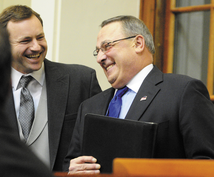 """Gov. Paul LePage, right, chats with Maine Speaker of the House Mark Eves, left, before the governor gives the State of the State address on Tuesday February 5, 2013 in the State House in Augusta. A conservative think tank says Gov. Paul LePage's two-year budget contains a """"subtle tax increase,"""