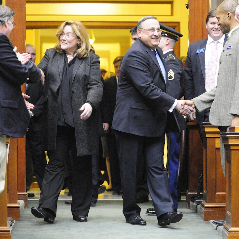 Leigh I. Saufley Chief Justice of the Maine Supreme Judicial Court, left, and Gov. Paul LePage enter the House before he delivers his the State of the State address on Tuesday, Feb. 5, 2013 at the State House in Augusta. LePage is shaking hands with Rep. Craig V. Hickman, D-Winthrop.