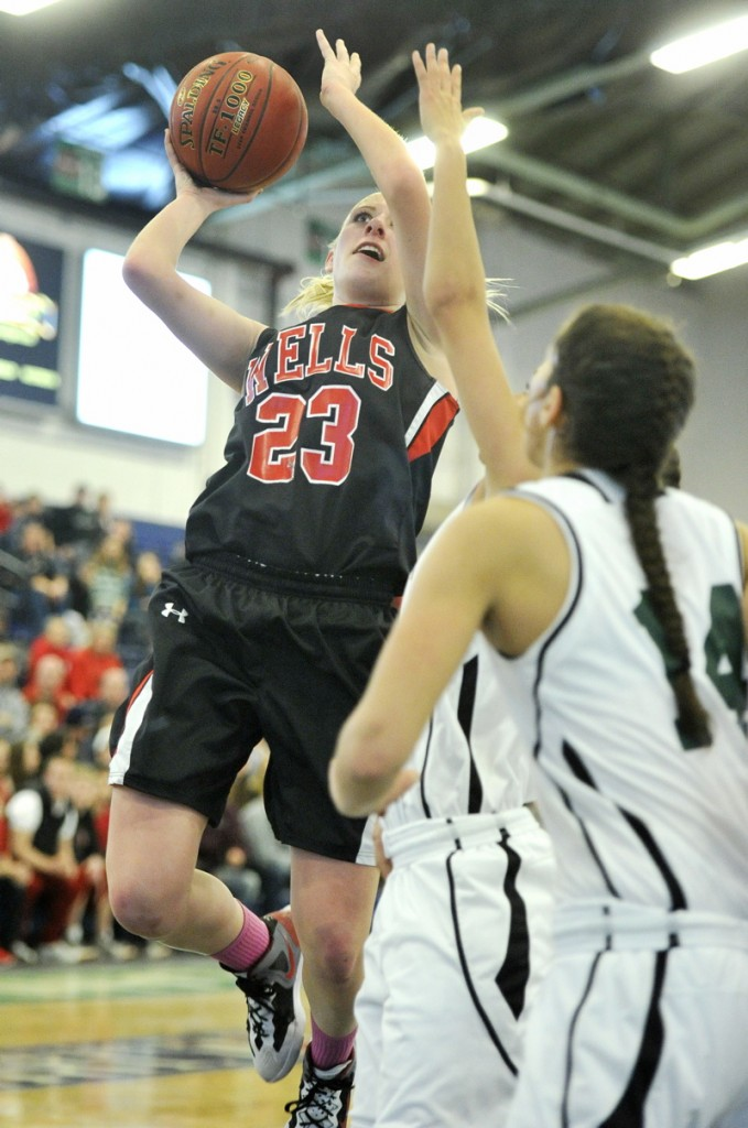 Alison Furness of Wells take a shot during a Western Class B girls' basketball quarterfinal Tuesday against Spruce Mountain. Wells, the No. 11 seed, advanced with a 43-42 win over the previously undefeated Phoenix.