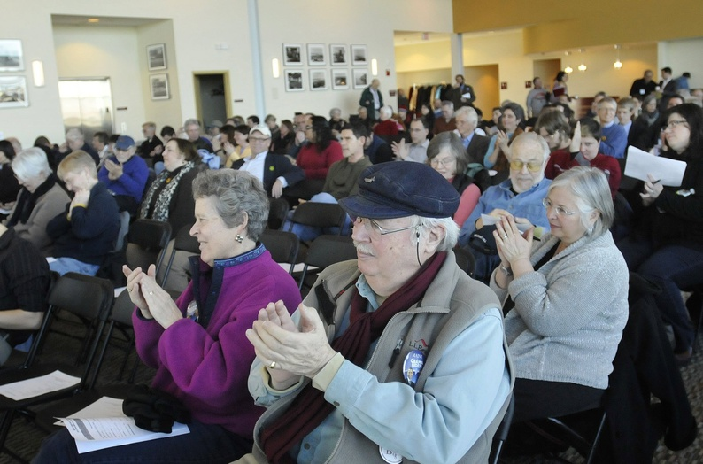 Those attending the Democratic caucus on Feb. 26, 2012, in Portland applaud a candidate. Maine should have a single, open primary for all candidates for statewide office and Congress.