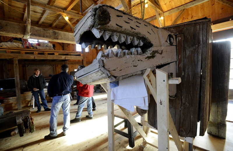 In this November 2012 file photo, a lion by Bernard Langlais is being restored at Preservation Timber Framing. The work of the late Maine artist Bernard
