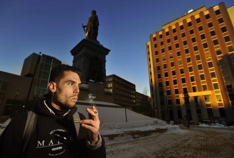 In this Jan. 7, 2012 file photo, Jason Lemay of Portland smokes a cigarette in Monument Square. Effective Wednesday, March 6, 2013 smoking will no longer be allowed in city parks, plazas and open spaces.