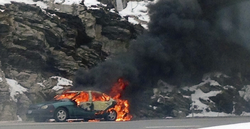 Flames envelope a car on I-295 Friday morning. Contributed photo by Sean Anderton.