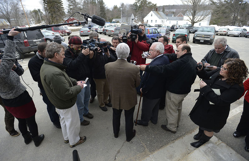 Mark Strong Sr. center, faces the media after he was found guilty of 12 counts of promotion of prostitution and one count of conspiring to promote prostitution Wednesday, March 6, 2013. To his right is his attorney Dan Lilley.