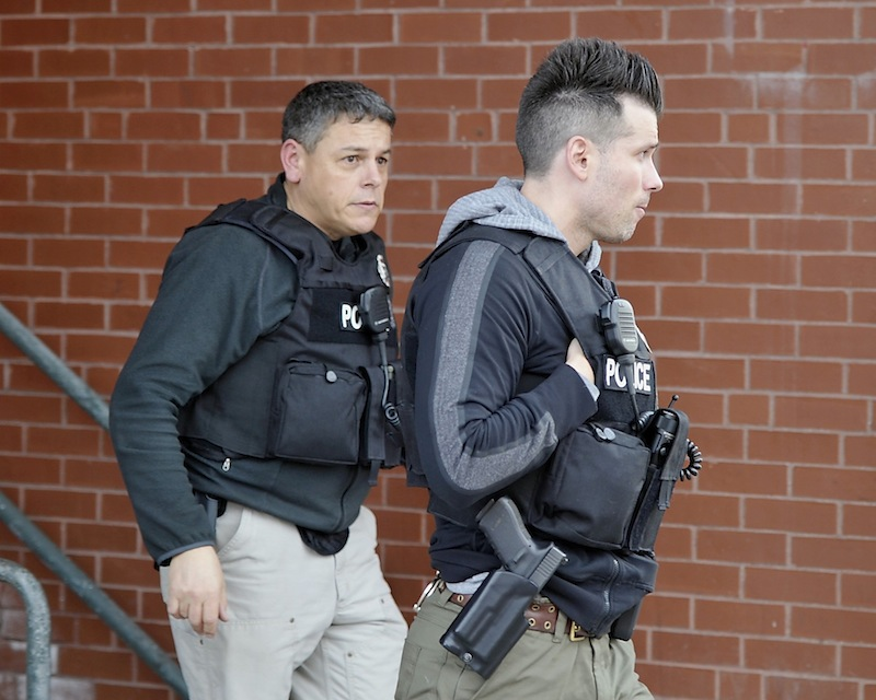 Police surround the Lafayette Square apartment complex after shots were fired on the sixth floor on Friday, March 15, 2013.