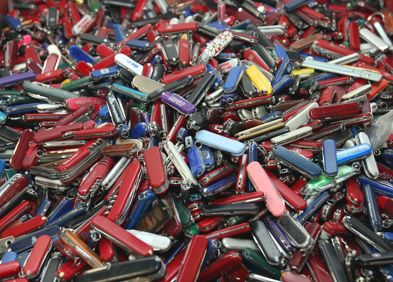 In this Sept. 26, 2006, file photo, knives of all sizes and types are piled in a box at the State of Georgia Surplus Property Division store in Tucker, Ga., and are just a few of the hundreds of items discarded at the security checkpoints of Hartsfield-Jackson Atlanta International Airport that will be for sale at the store. Airline passengers will be able to carry small knives, souvenir baseball bats, golf clubs and other sports equipment onto planes beginning in April 2013 under a policy change announced Tuesday, March 5, 2013, by the head of the Transportation Security Administration administrator John Pistole. (AP Photo/Gene Blythe, File)