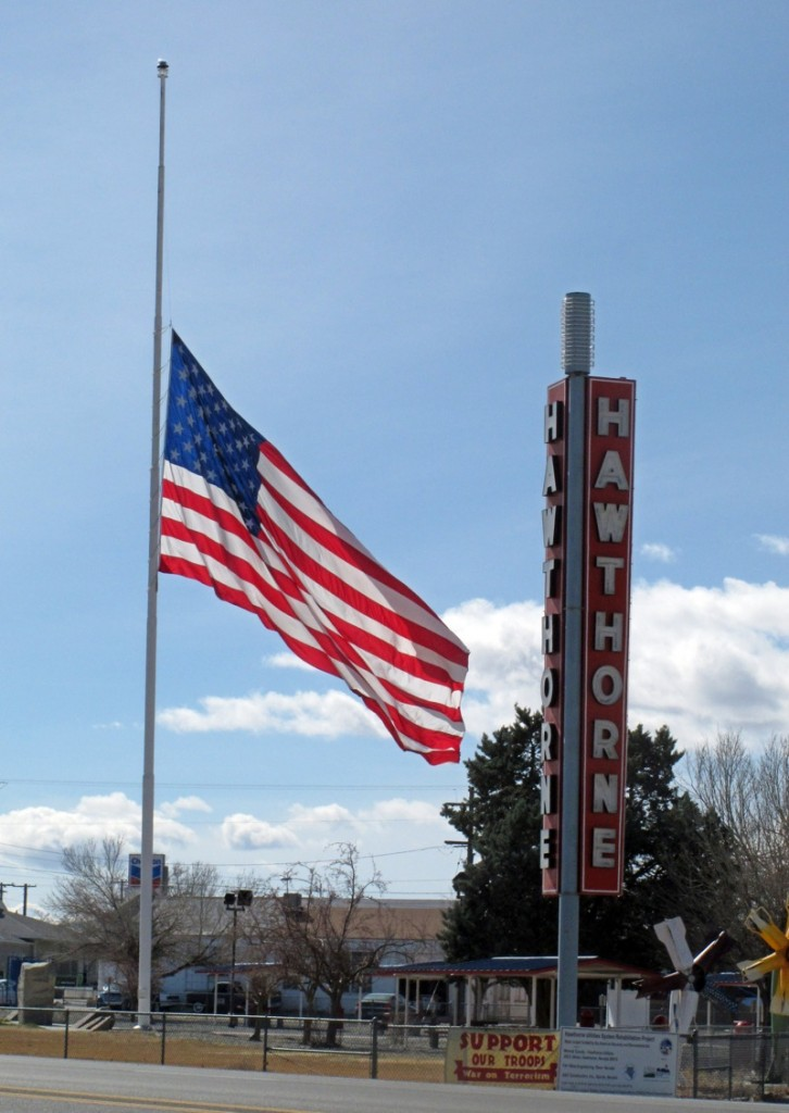 An American flag waves at half staff in the town of Hawthorne near the Hawthorne Army Depot on Tuesday, March 19, 2013, where seven Marines were killed and several others seriously injured in a training accident Monday night, about 150 miles southeast of Reno in Nevada's high desert. (AP Photo/Scott Sonner)