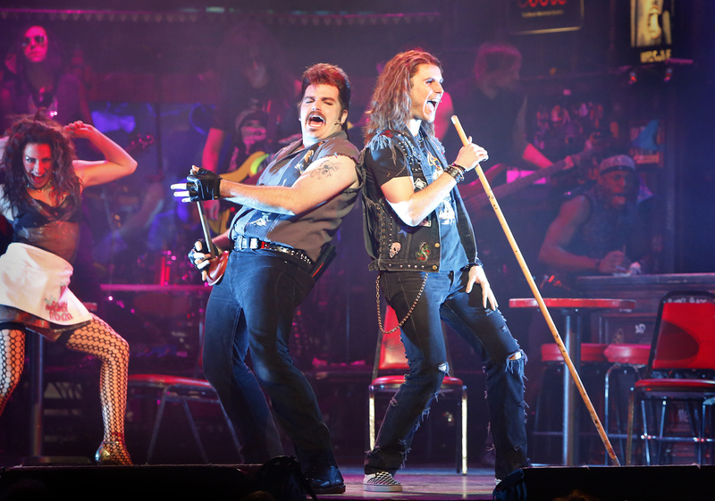"Justin Colombo as Lonny, left, and Dominique Scott as Drew perform ""Nothin' But a Good Time"" by Poison in ""Rock of Ages"" at Merrill Auditorium in Portland on Saturday."