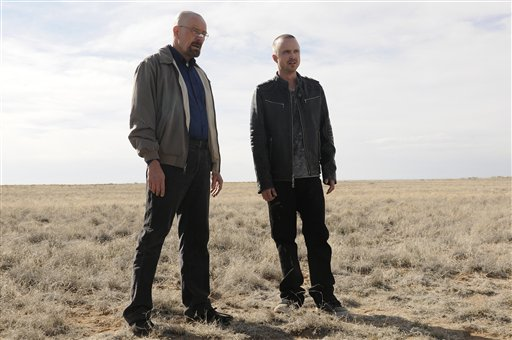 This image released by AMC shows Bryan Cranston as Walter White, left, and Aaron Paul as Jesse Pinkman in a scene from the season 5 premiere of