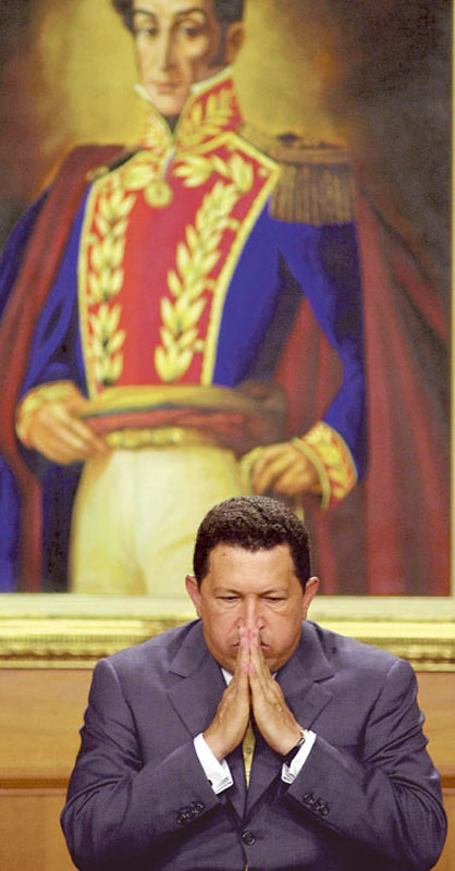 Chavez sits before a painting of Venezuelan independence hero Simon Bolivar at the presidential palace in Caracas.