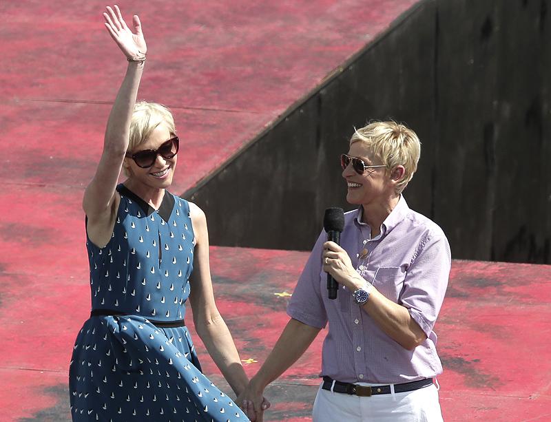 Talk show host Ellen DeGeneres, right, introduces her wife, Portia de Rossi, Saturday in Sydney, Australia.