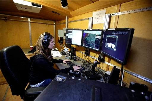 Flight test operator Hannah Rasmussen monitors unmanned aricraft controls at a ground control station in Arlington, Ore.