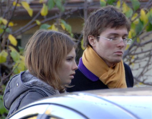 This 2007 file photo shows Amanda Marie Knox, left, and her then-boyfriend Raffaele Sollecito, of Italy, outside the rented house where 21-year-old British student Meredith Kercher was found dead in Perugia, Italy.