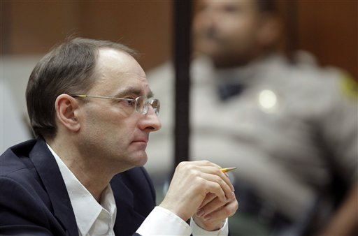 Christian Karl Gerhartsreiter listens during opening statements in his trial in Los Angeles Criminal Court on Monday. A prosecutor told jurors he will prove a cold-case murder allegation against the German immigrant who spent years moving through U.S. society under a series of aliases, most notoriously posing as a member of the fabled Rockefeller family.