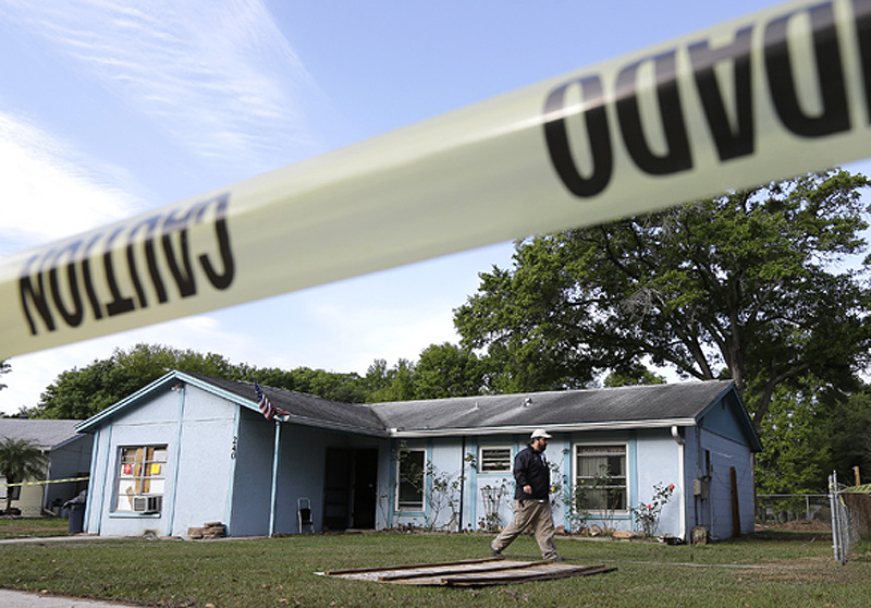 In this file photo, a Seffner, Fla., man is presumed dead after a sinkhole opened under this house late May 2014. His brother jumped into the hole to try to save him, but had to be rescued himself as the ground crumbled around him.