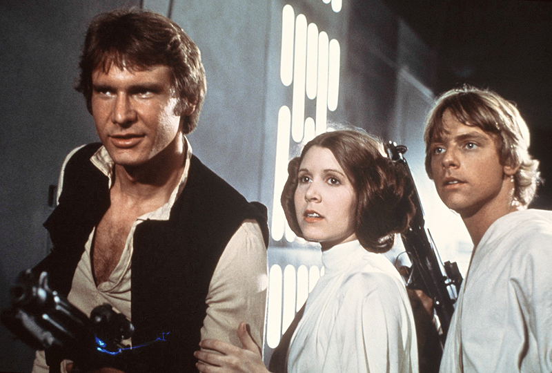 """In a theater long ago ..... above, from left, Harrison Ford, Carrie Fisher, and Mark Hamill in """"Star Wars"""" in 1977."""