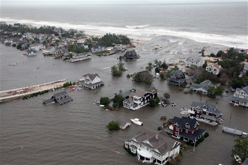 This Oct. 30, 2012, file photo shows an aerial view of the damage to the shoreline and the houses in Mantoloking, N.J., the day after Superstorm Sandy. A rising number of homes damaged by Sandy are hitting the market – ranging from 10 percent off pre-storm prices for upscale homes in New York's Long Island and the Jersey Shore to up to 60 percent off modest bungalows in Staten Island and Queens – but it's very much a game of buyer beware.