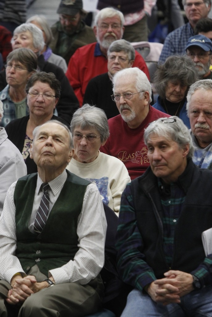 Citizens listen to debate at town meeting on Tuesday, March 5, 2013 in Craftsbury, Vt. Vermonters are heading to their town halls and school gymnasiums for Town Meeting to vote on town and school budget. (AP Photo/Toby Talbot)