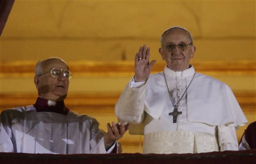 Pope Francis waves to the crowd from the central balcony of St. Peter's Basilica at the Vatican on Wednesday. Bergoglio, who chose the name of Francis, is the 266th pontiff of the Roman Catholic Church.