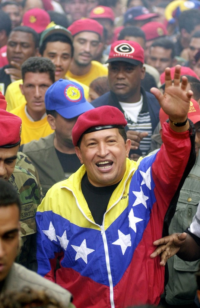 In this Jan. 23, 2002 file photo, Venezuela's President Hugo Chavez waves to supporters during a government march commemorating the anniversary of Venezuelan democracy in Caracas, Venezuela. Venezuela's Vice President Nicolas Maduro announced on Tuesday, March 5, 2013 that Chavez has died. Chavez, 58, was first diagnosed with cancer in June 2011. (AP Photo/Fernando Llano, File)