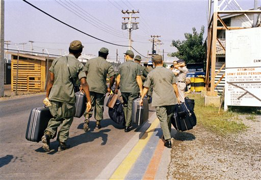 In this March 29, 1973, photo, Camp Alpha, Uncle Sam's out processing center, was chaos in Saigon. Lines of bored soldiers snaked through customs and briefing rooms. As the last U.S. combat troops left Vietnam 40 years ago, angry protesters still awaited them at home. North Vietnamese soldiers took heart from their foes' departure, and South Vietnamese who had helped the Americans feared for the future.