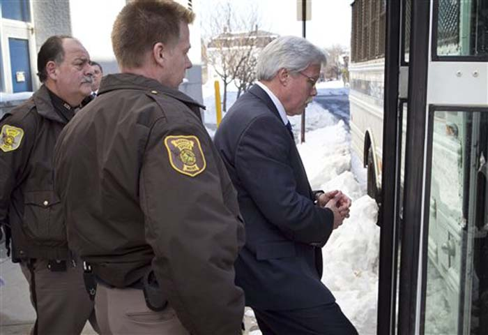Mark Strong Sr. leaves the Cumberland County Courthouse and is taken to jail after receiving a 20-day sentence and a $3,000 fine for his role in the Zumba prostitution case.