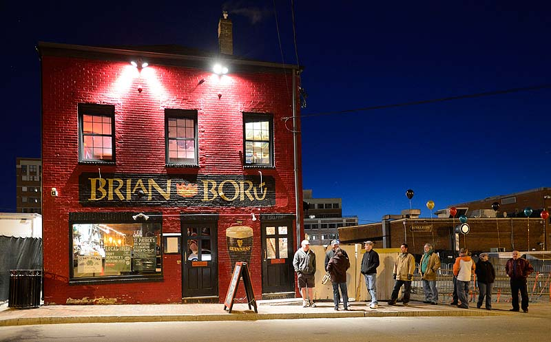 Early revelers wait in line shortly before 6 a.m. for Brian Boru to open for its St. Patrick's Day celebration Sunday.
