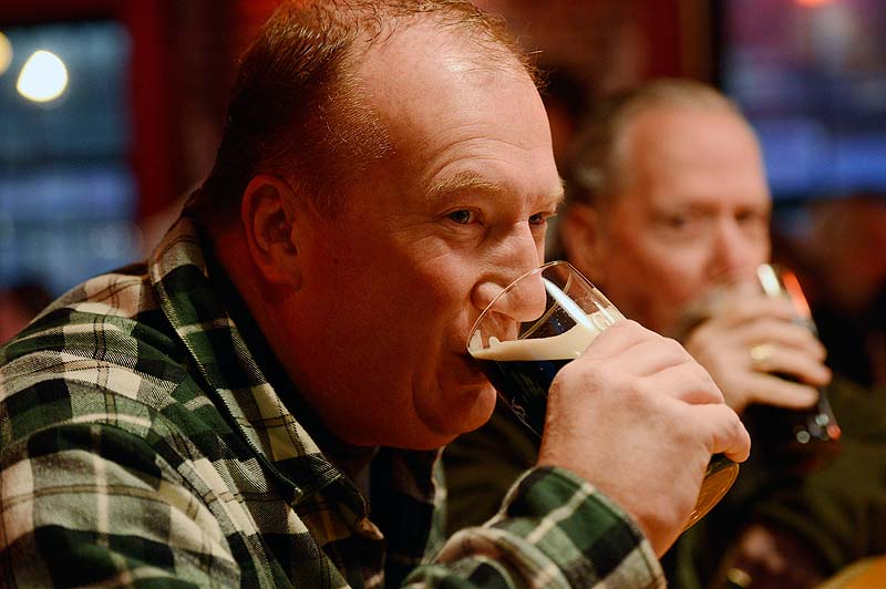 Hal Cozens of Orlando, Fla., takes a sip of his pint during St. Patrick's Day celebrations at Brian Boru on Sunday. Cozens says he came back to his hometown of Portland to celebrate St. Patrick's Day.