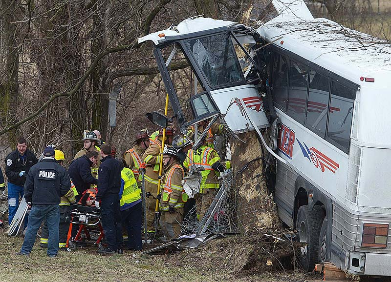 Emergency crews respond after a bus carrying the Seton Hill University women's lacrosse team crashed on the Pennsylvania Turnpike on Saturday near Carlisle, Pa.
