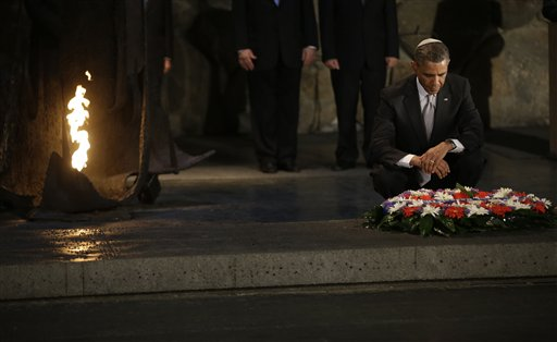 U.S. President Barack Obama, right, pauses after laying a wreath during his visit to the Hall of Remembrance at the Yad Vashem Holocaust Memorial in Jerusalem, Israel, Friday, March 22, 2013. (AP Photo/Pablo Martinez Monsivais)