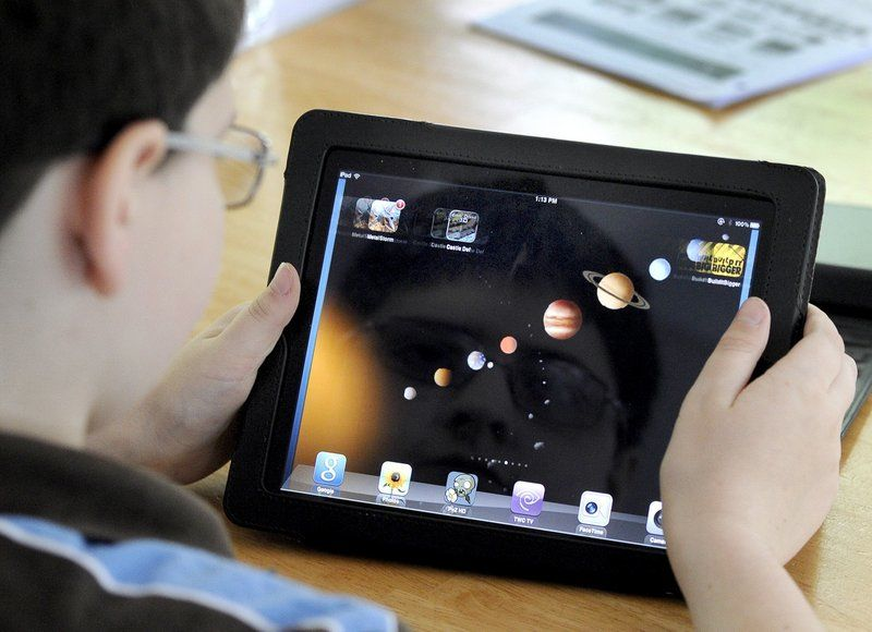 State officials say iPads would be less expensive than laptops and believe they are powerful enough to meet requirements. There are drawbacks though, some say, like typing on the screen.