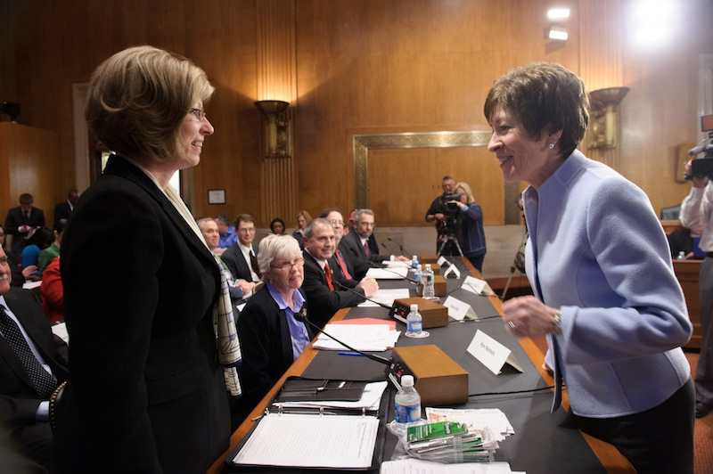 Sen. Susan Collins, R-Maine, talks with Hermon resident Kim Nichols, left, on Thursday before a hearing of the Senate Special Committee on Aging about lottery scams targeting senior citizens. Nichols' father, who lives in New Hampshire, lost $85,000 to the Jamaica-based scammers. Aging Committee Collins Susan M. (R-ME)