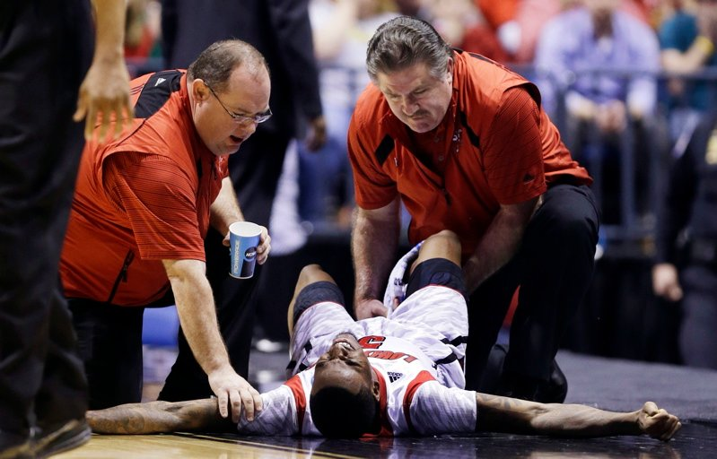 Medical personnel attend to Kevin Ware after the Louisville guard suffered an apparent broken leg during the NCAA Midwest Regional final Sunday against Duke.