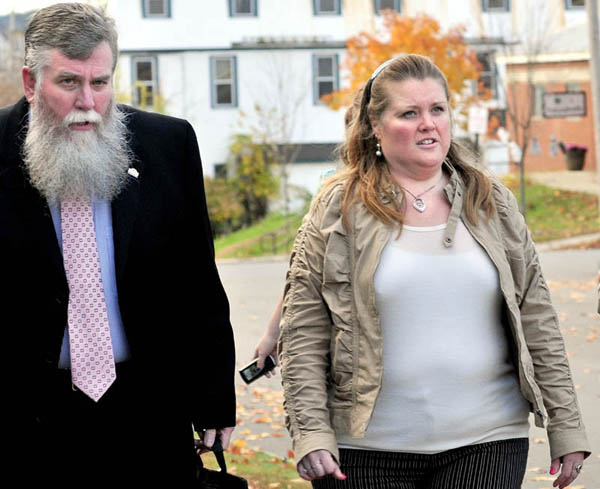 In this October 2012 file photo, Amanda Huard and attorney John Youney enter Skowhegan District Court. Huard's daughter Kelli Murphy, 11, has been charged with manslaughter in the death of Brooklyn Foss-Greenaway.