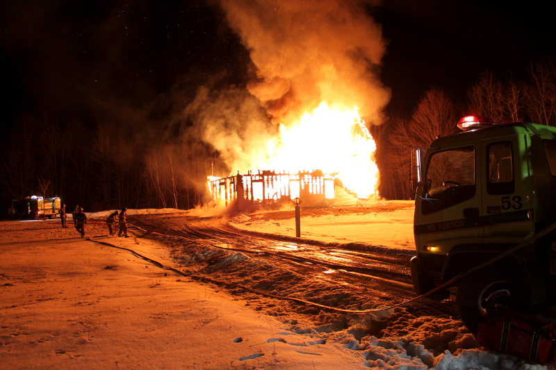 Firefighters battle the flames that destroyed Eric Whitehouse's Bean Road, Mount Vernon home early Sunday morning.