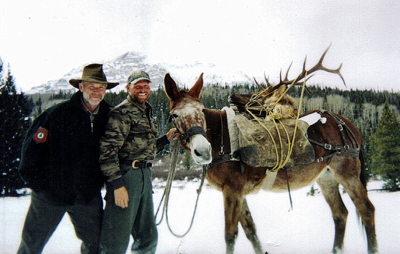 Roger Lambert, left, celebrates a successful 2006 elk hunt in Colorado with son Russ, who manages Steamboat Lake Outfitters in Colorado, which specializes in high-altitude hunts. The younger Lambert will be among the outfitters at the upcoming State of Maine Sportsman's Show in Augusta.