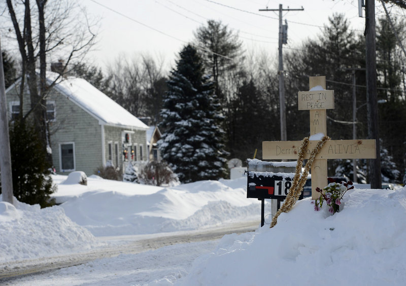 In this file photo, a makeshift memorial stands across from 17 Sokokis Road in Biddeford, where Derrick Thompson and Alivia Welch were shot dead.