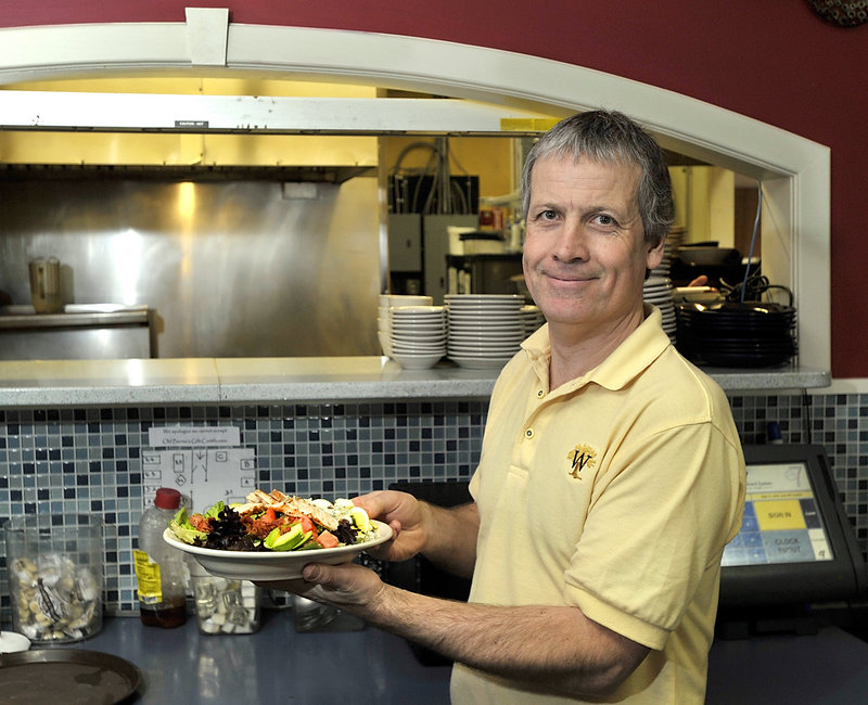 Philip Ryle prepares to serve a Cobb salad to a customer at Bernie's – soon to be Madden's.