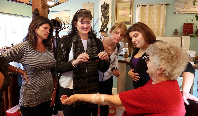 At right, Barbara Roggio of Thomaston shows off the tattoo she got Thursday, Feb. 28, 2013 at Tsunami Tattoo in Portland in honor of her late daughter Robyn Hesseltine. Looking on from left is Sharon Boucher of Acton, Mass., Barbara Osmond of Rock Hill, S.C., Cheryl Spataro of California and Jennifer Osmond of Rock Hill, S.C., who all also received tattoos.
