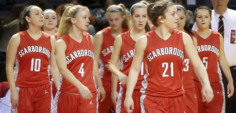"Six seniors on the Scarborough girls basketball team – from left, Marisa O'Toole, Grace Farnkoff, Maria Philbrick, Taylor LeBorgne, Courtney Alofs and Mary Redmond – walk onto the court for their semifinal game against Catherine McAuley High School at the Cumberland County Civic Center in Portland on Feb. 22. Because Scarborough lost, it would turn out to be their last game together, ""but we gave everything we had,"" Farnkoff said."