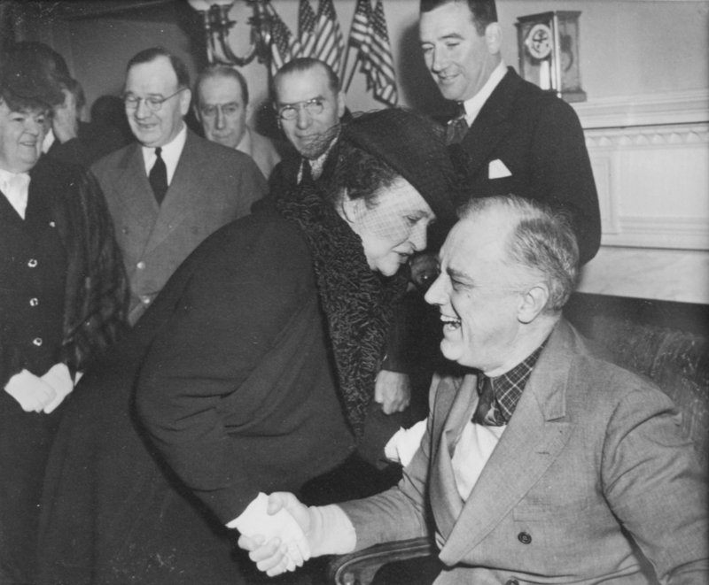Frances Perkins, the first woman appointed to a U.S. Cabinet post,greets President Franklin Roosevelt in this 1940s photo.