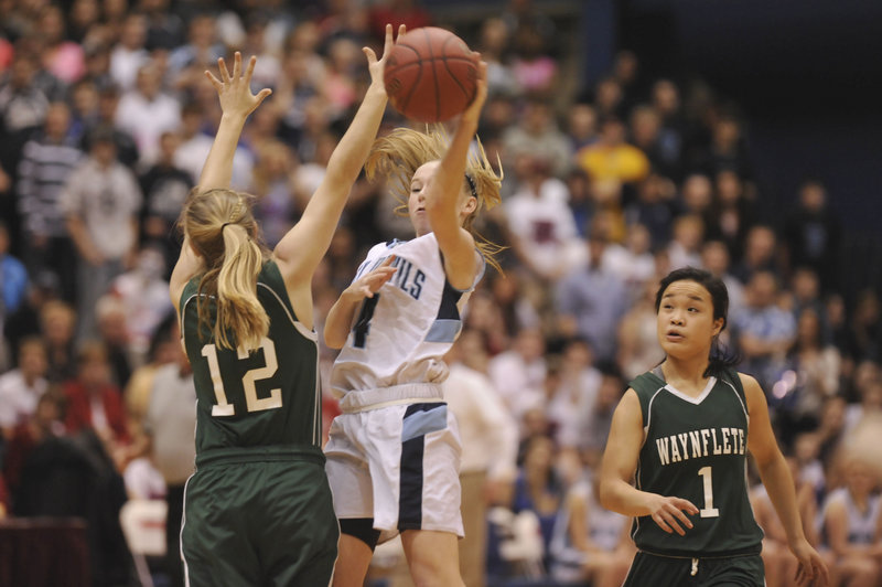 Martha Veroneau of Waynflete forces Maddy McVicar of Calais into a pass during Waynflete's 59-55 victory on Saturday night. Veroneau is among the finalists for the Maine Association of Basketball Coaches' Mr. and Miss Basketball award.