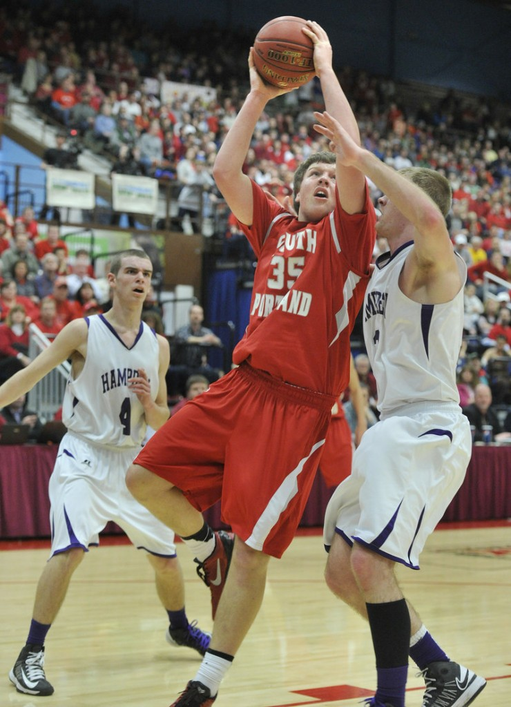 Jaren Muller of South Portland finds room to penetrate while defended by Brian Fickett. Hampden won the state championship after falling to Deering in last year's final.