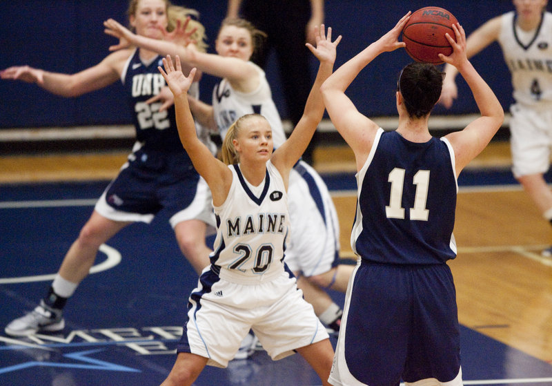 Maine guard Sophie Weckstrom puts pressure on Kaylee Kilpatrick of the University of New Hampshire, during an 86-63 New Hampshire win at Orono on Saturday.