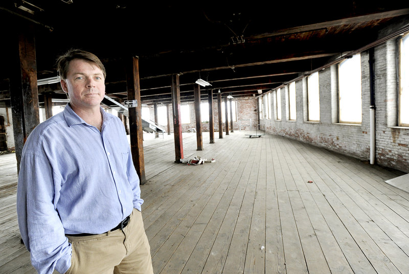Scott Joslin, COO of the Pepperell Mill Campus, stands inside the site of a proposed hotel and restaurant Monday, March 4, 2013 to be located at the old Biddeford mill complex.