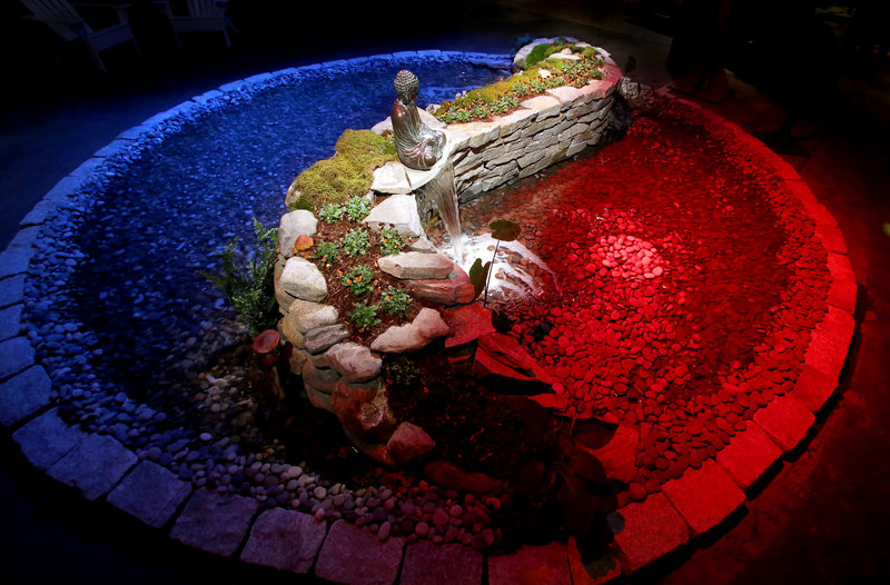 A yin-yang water garden created by Robins Nest Aquatics is one of the many displays for visitors during the opening night of the