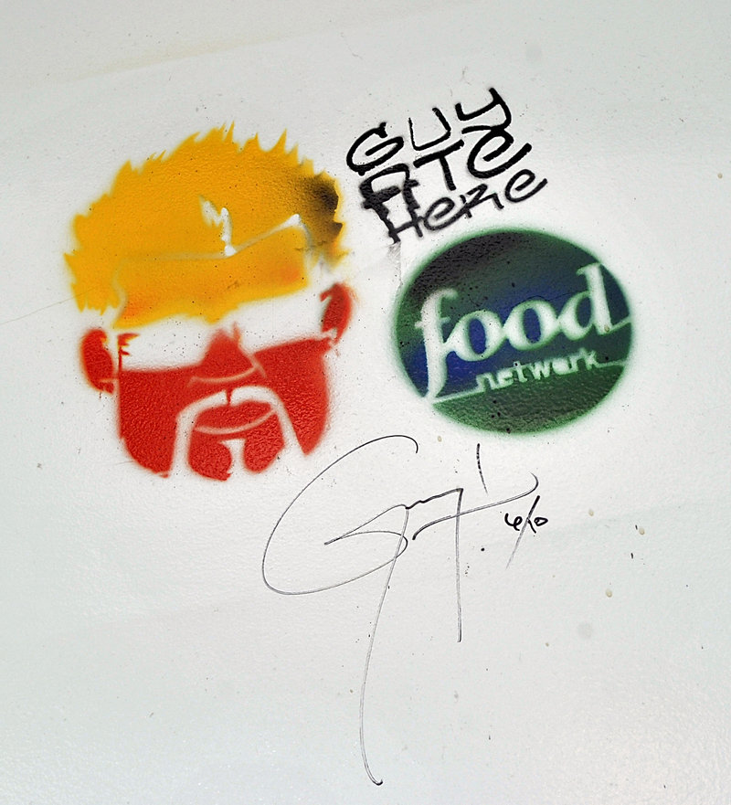 """Guy Fieri left his mark when his Food Network show """"Diners, Drive-Ins and Dives"""" visited the old Porthole in 2011. New owner Ken Macgowan said he plans to preserve the image in the restaurant's newly renovated space."""