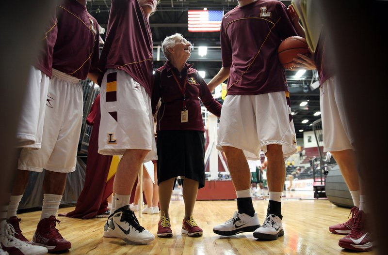 Sister Jean Dolores Schmidt says her pre-game prayer for the Loyola men's basketball team a week ago in Chicago. Her prayers were answered when the team won its last regular-season game, 87-60, against Cleveland State University before going on the road for the Horizon League playoffs.